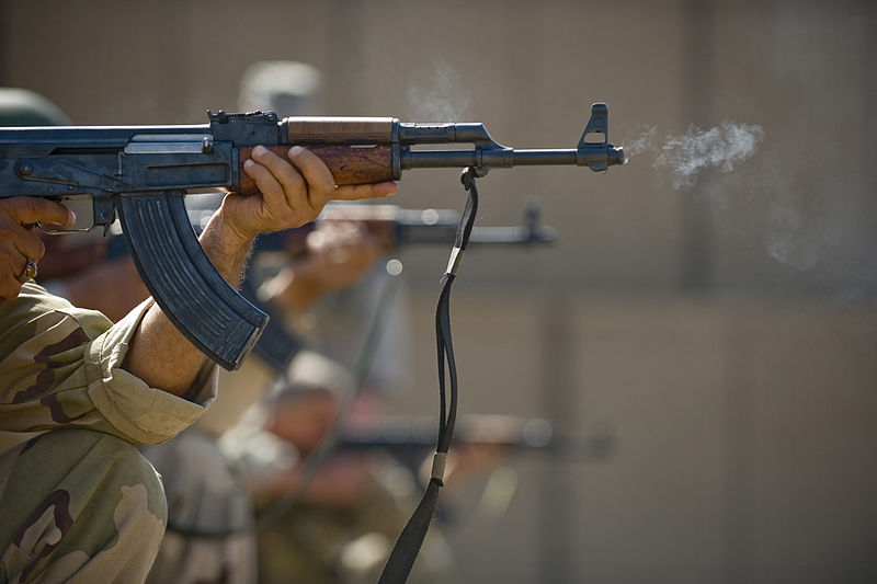 Iraqi airmen fire AK-47s during firing drills March 29, 2011, U.S. Air Force / Staff Sgt. Levi Riendeau, public domain