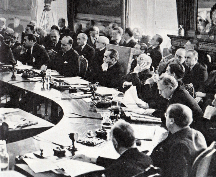 Stanley Bruce chairing the League of Nations Council in 1936. Joachim von Ribbentrop is addressing the council, Commonwealth of Australia, public domain