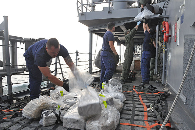 USS Rentz confiscates cocaine, Official U.S. Navy Page from United States of America Lt. Cmdr. Corey Barker/U.S. Navy, public domain