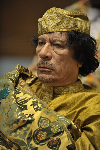 Muammar al-Gaddafi at the 12th AU summit, February 2, 2009, in Addis Abeba. 2 February 2009, United States Navy, Public Domain