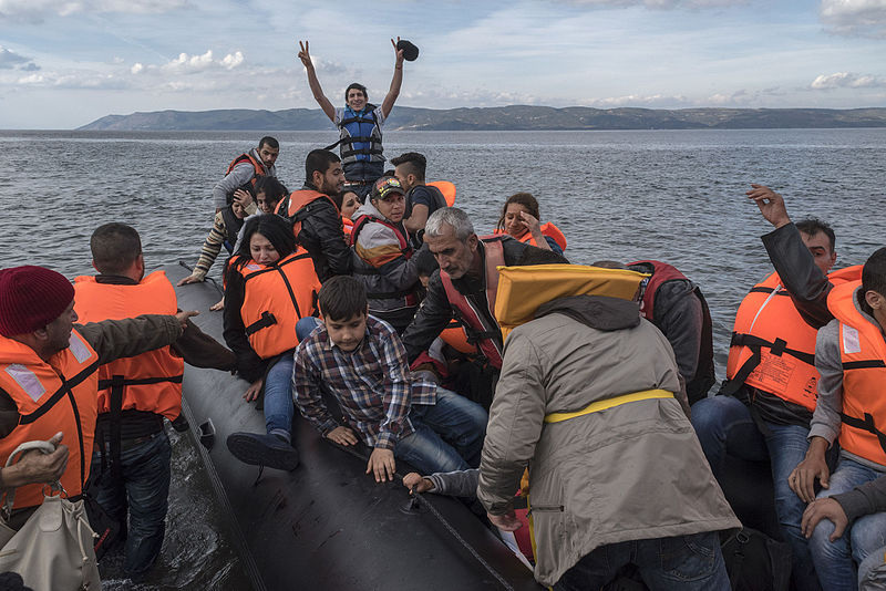 An inflatable boat with Syrian Refugees just arrived safely to Skala Sykamias, Lesvos island, Greece, Ggia, CC 4.0