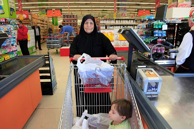 A Syrian refugee woman completing her shopping in Amman, Jordan. Food vouchers from the World Food Programme, funded by UK aid, are providing a lifeline for some of the nearly 600,000 Syrian refugees in Jordan. DFIK, CC 2.0