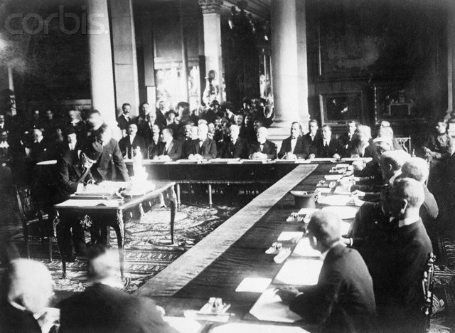 23 Aug 1920, Sevres, France --- 8/23/1920-Sevres, France: Signing the Turkish Treaty with the Allies- Photo shows Haki Pacha signing. The inkstand being used is the one ordered by the Kaiser in 1914 for his personal use. --- Image by © Bettmann/CORBIS